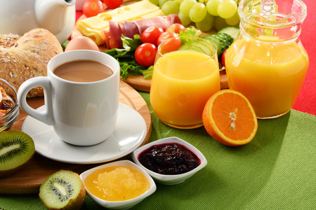 Breakfast served with coffee, orange juice, egg, rolls and fruits. Balanced diet. Stock Photo