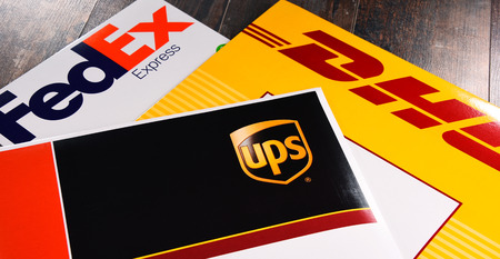 POZNAN, POL - AUG 2, 2017: Envelopes of 3 most popular courier services in the world: UPS, FedEx and DHL