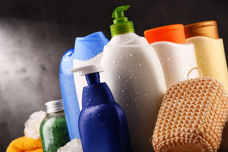 Plastic bottles of body care and beauty products. Banco de Imagens