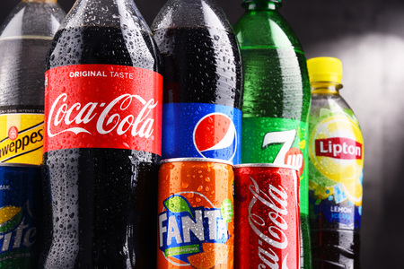 fizz: POZNAN, POLAND - AUG 18, 2017: Global soft drink market is dominated by brands of few multinational companies founded in North America. Among them are Pepsico, Coca Cola and Dr. Pepper Snapple Group