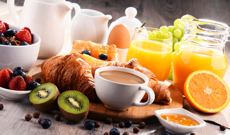 Breakfast served with coffee, orange juice, croissants, cereals and fruits. Balanced diet. Stock Photo - 85183499