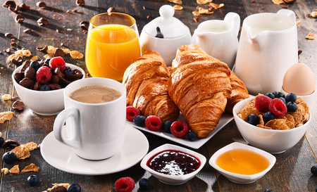 Breakfast served with coffee, orange juice, croissants, cereals and fruits. Balanced diet. Stock Photo - 86796420