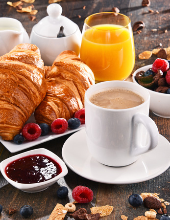 Breakfast served with coffee, orange juice, croissants, cereals and fruits. Balanced diet. Stock Photo - 86796428