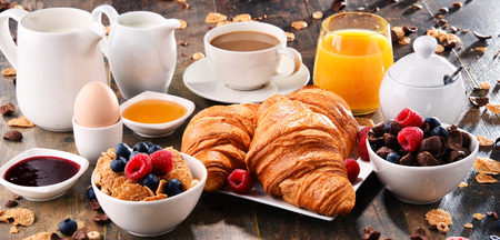 Breakfast served with coffee, orange juice, croissants, cereals and fruits. Balanced diet. Stock Photo - 86796432