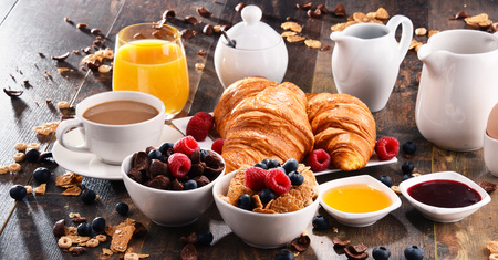 Breakfast served with coffee, orange juice, croissants, cereals and fruits. Balanced diet. Stock Photo - 87482789