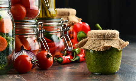 encurtidos: Jars with marinated food and organic raw vegetables. Foto de archivo