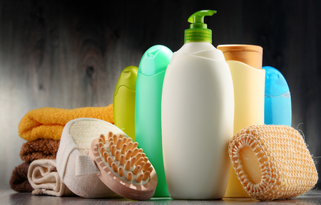 Plastic bottles of body care and beauty products. 免版税图像