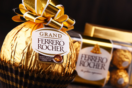 POZNAN, POLAND - DEC 7, 2017: Ferrero Rocher premium chocolate sweets produced by the Italian chocolatier Ferrero SpA., sold in over 40 countries in amount of about 3.6 billion a year Editorial