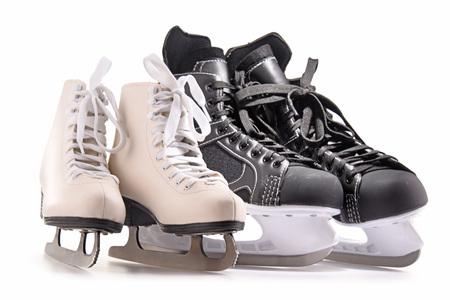 Ice hockey skates and figure skates isolated on white background.