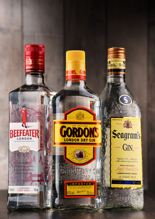 POZNAN, POLAND - DEC 15, 2017: Bottles of popular global gin brands: Gordons, Beefeater and Seagram