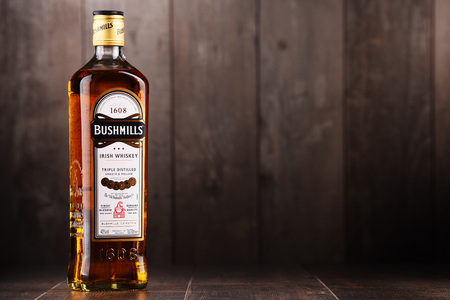 POZNAN, POLAND - DEC 15, 2017: Bottle of Bushmills Original Irish whiskey, product of  Old Bushmills Distillery founded in 1608, today owned by Casa Cuervo Editorial