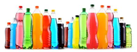Plastic bottles of assorted carbonated soft drinks over white background 版權商用圖片