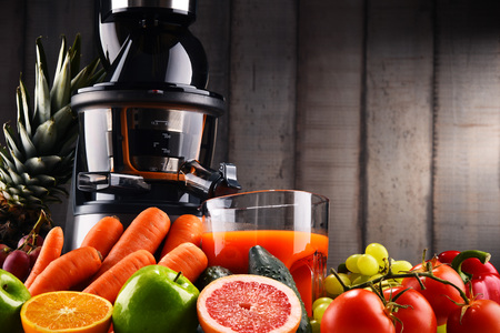 Slow juicer with organic fruits and vegetables. Detox diet