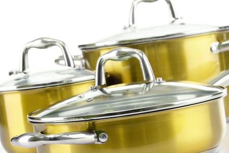 Composition with three steel pots. Standard-Bild