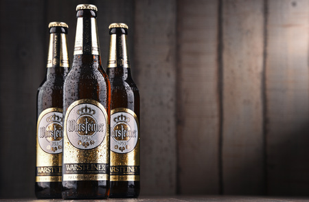 POZNAN, POLAND - FEB 14, 2018: Bottles of Warsteiner Premium Verum, the most popular beer of Warsteiner, Germany's largest privately owned brewery, operating since 1753 Stockfoto - 99102761