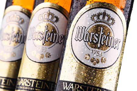 POZNAN, POLAND - FEB 14, 2018: Bottles of Warsteiner Premium Verum, the most popular beer of Warsteiner, Germany's largest privately owned brewery, operating since 1753 Stockfoto - 99102770