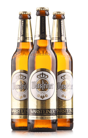 POZNAN, POLAND - FEB 14, 2018: Bottles of Warsteiner Premium Verum, the most popular beer of Warsteiner, Germanys largest privately owned brewery, operating since 1753 Redactioneel
