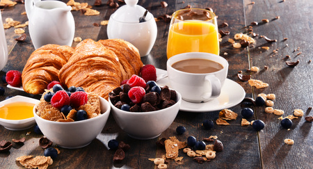 Breakfast served with coffee, orange juice, croissants, cereals and fruits. Balanced diet. Stock Photo - 96399161