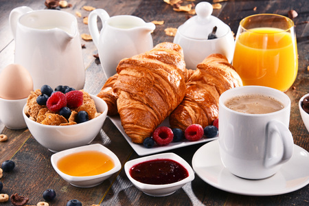 Breakfast served with coffee, orange juice, croissants, cereals and fruits. Balanced diet. Stock Photo - 96399165