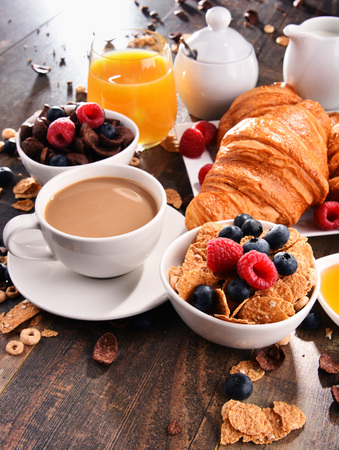 Breakfast served with coffee, orange juice, croissants, cereals and fruits. Balanced diet.