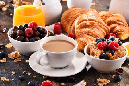 Breakfast served with coffee, orange juice, croissants, cereals and fruits. Balanced diet. Stock Photo - 96398703