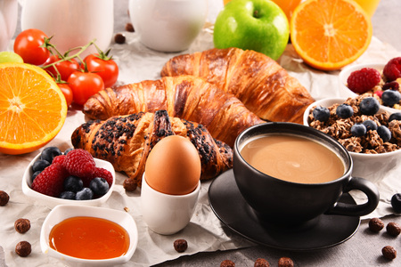 Breakfast served with coffee, orange juice, croissants, egg, cereals and fruits. Balanced diet. Stock Photo - 96871103