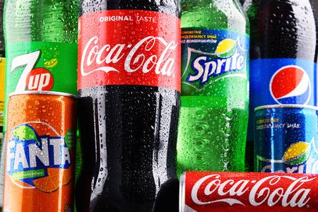 POZNAN, POLAND - DEC 15, 2017: Bottles of global soft drink brands including products of Coca Cola Company and Pepsico