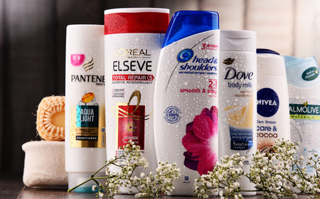 POZNAN, POLAND - DEC 7, 2017: Plastic containers of body care products including widely available most popular global brands as LOreal, Nivea, Dove, Palmolive, Head & Shoulders and Schwarzkopf