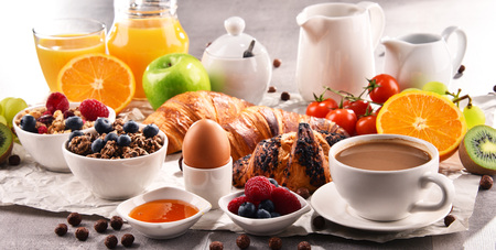 Breakfast served with coffee, orange juice, croissants, egg, cereals and fruits. Balanced diet. Stock Photo - 97376688