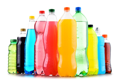 Plastic bottles of assorted carbonated soft drinks over white background Standard-Bild - 97376730