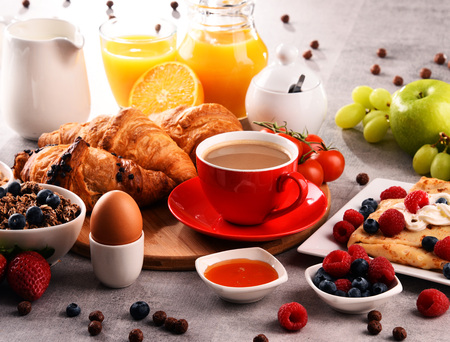 Breakfast served with coffee, orange juice, croissants, egg, cereals and fruits. Balanced diet. Stock Photo - 97376994