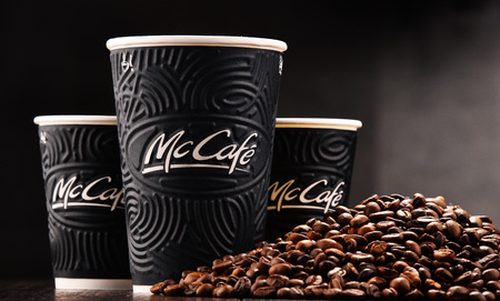 POZNAN, POLAND - MAR 7, 2018: McCafe cup of coffee, a brand of a coffee-house-style food and drink chain, owned by McDonald's.