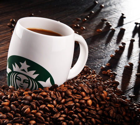 POZNAN, POLAND - MAR 7, 2018: Starbucks, coffee company and coffeehouse chain, founded in Seattle, Wa. USA, in 1971; now the largest business of this kind in the world operates over 27,000 locations