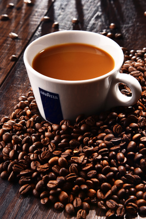 POZNAN, POLAND - MAR 7, 2018: Cup of Lavazza coffee, a brand owned by an Italian manufacturer of coffee products, founded in Turin in 1895 by Luigi Lavazza.