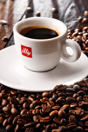 POZNAN, POLAND - MAR 7, 2018: Cup of Illy coffee, a brand of Italian coffee roasting company that specializes in the production of espresso. Founded by Francesco Illy in 1933. Editöryel