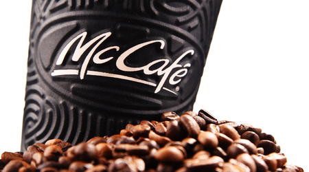 POZNAN, POLAND - MAR 7, 2018: McCafe cup of coffee, a brand of a coffee-house-style food and drink chain, owned by McDonalds.