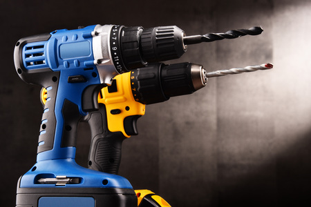 Two cordless drilsl with drill bits working also as screw guns. Stok Fotoğraf - 97948344
