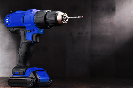 Cordless drill with drill bit working also as screw gun. 스톡 콘텐츠