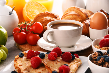 Breakfast served with coffee, orange juice, croissants, egg, cereals and fruits. Balanced diet. Stock Photo - 100072385