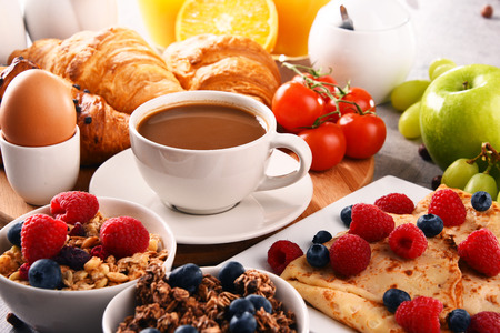 Breakfast served with coffee, orange juice, croissants, egg, cereals and fruits. Balanced diet. Stock Photo - 100072686