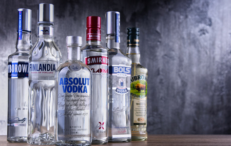 POZNAN, POLAND - MAR 30, 2018: Bottles of several global brands of vodka, the world's largest internationally traded spirit with the estimated sale of about 500 million nine-liter cases a year. Editorial