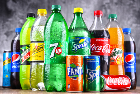 POZNAN, POLAND - APR 6, 2018: Bottles of global soft drink brands including products of Coca Cola Company and Pepsico Éditoriale