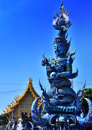 Statue at Wat Rong Seua Ten or the Blue Temple, a Buddhist temple in Chiang Rai, Thailand Stock Photo