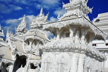 Architecture at Wat Rong Khun or the White Temple, a Buddhist temple in Chiang Rai, Thailand