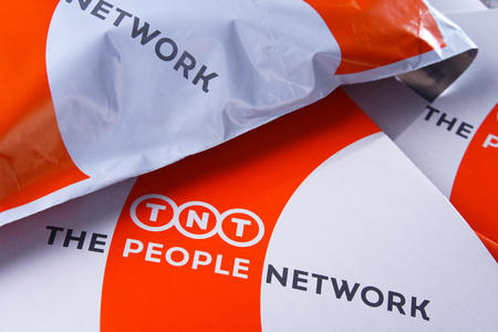 POZNAN, POL - APR 26, 2018: Envelopes and parcels of TNT Express, a Dutch courier delivery services company headquartered in Hoofddorp, Netherlands, subsidiary of FedEx. Редакционное