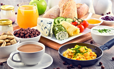 Breakfast served with coffee, orange juice, cheese, cereals and scrambled eggs. Balanced diet.