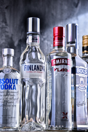POZNAN, POLAND - MAR 30, 2018: Bottles of several global brands of vodka, the worlds largest internationally traded spirit with the estimated sale of about 500 million nine-liter cases a year. Editorial