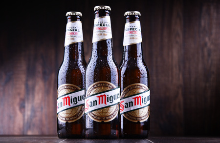 POZNAN, POL - JUN 7, 2018: Bottles of San Miguel Beer, a Filipino pale lager produced by San Miguel Brewery since 1890.