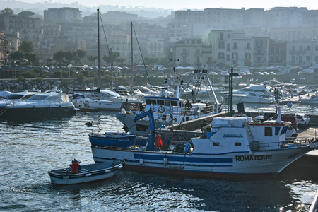 POZZUOLI, ITALY - MAY 26, 2018: Pozzuoli harbour after sunrise, a comune of the Metropolitan City of Naples, Campania, Italy. Editorial