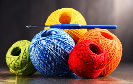 Colorful yarn for crocheting and hook on wooden table. Stok Fotoğraf
